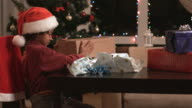 Black boy opening Christmas present. video