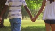 Black boy, white girl, children holding hands video