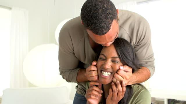Black boyfriend pinching woman's face video
