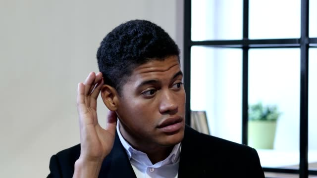 Black Businessman Listening Secret Carefully video