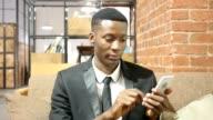 Black Businessman Using Smartphone, Indoor video