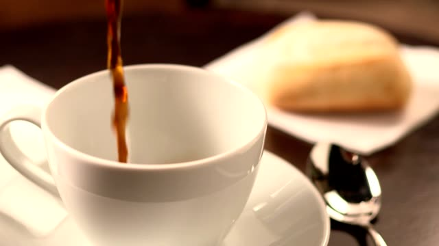 Black coffee pouring into cup video