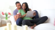 Black couple sharing information on their devices video