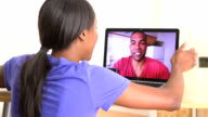 Black couple talking with family back home video