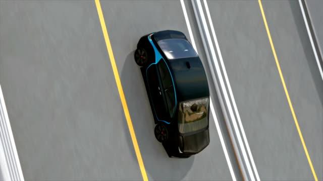 Black electric car driving on loop bridge video