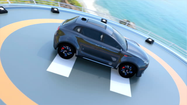 Black electric SUV parking on the helipad video