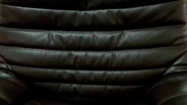 Black elegant office chair. Close-up video