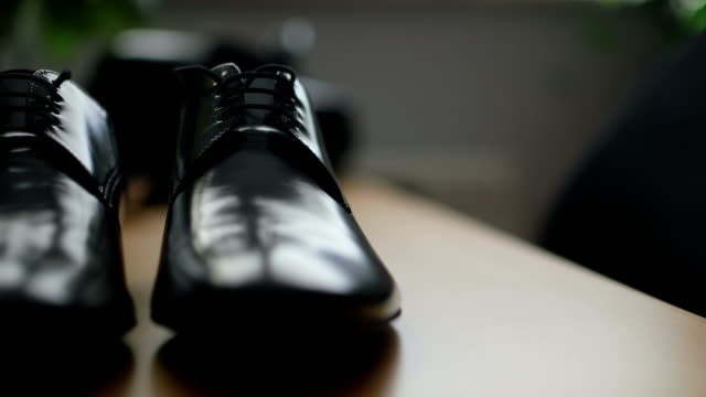 Black elegant shoes laying on the wooden shelf. video