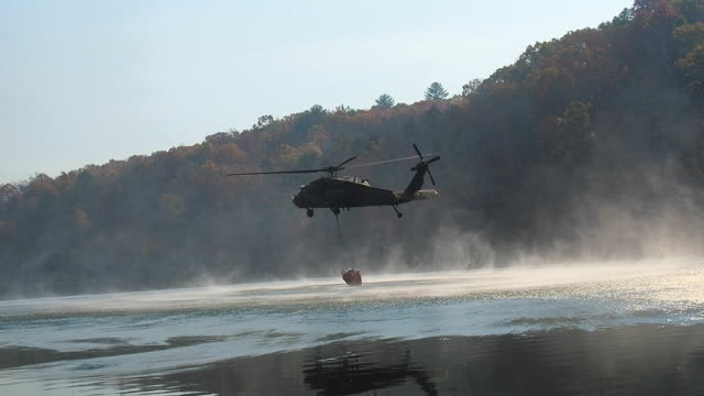 Black hawk helicopter picking up water video