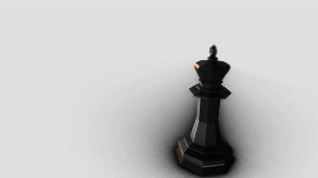 Black king piece in a white background video