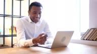 Black Man Using Smartphone at Work video