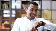 Black Man Using Smartwatch in Office video
