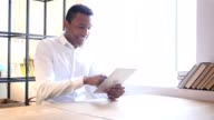 Black Man Using Tablet in Office video