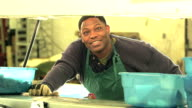 Black man working in seafood processing plant video