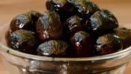 Black olives in a bowl video