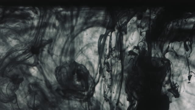 Black paint drops in the water video