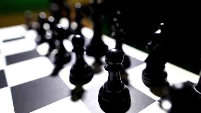Black pieces on a chess board video