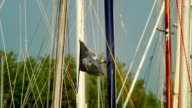 Black pirate flag on the wind, skull and crossbones, yachting video