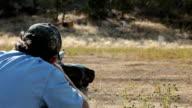 Black powder rifle over shoulder Slow video