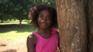 Black school girl hugging tree in park, ecology, people video