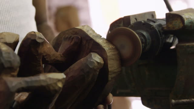 Black sculptor, artist workshop, art, wood statue, crafts video