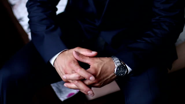 Black suit and expensive watch video