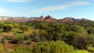 AERIAL: Black SUV car driving through beautiful Sedona state park, Arizona video