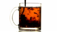 Black tea is stirred with a spoon video