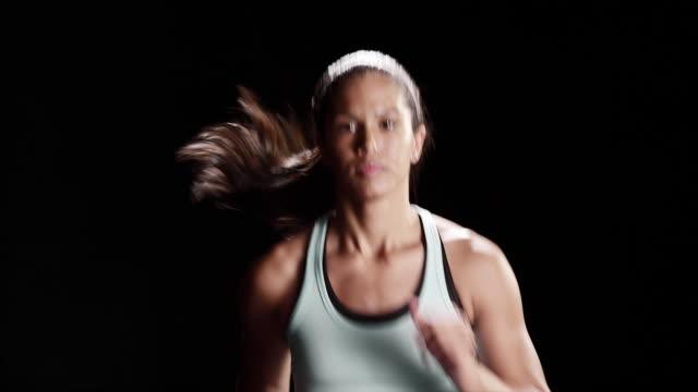 Black Woman jogging on a treadmill video