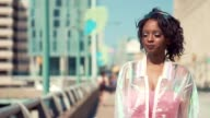Black woman sad on a clear summer day in the city video