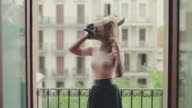 Black woman with horse head on the balcony video