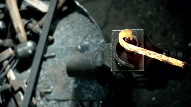 HD: Blacksmith Bending Wrought Iron video