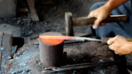 Blacksmith making knife. video