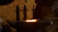 Blacksmith puts on anvil billet a hot metal and begins to strike video