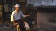 Blacksmith starting a fire in his furnace video