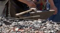 Blacksmith working near glowing embers video