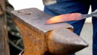 Blacksmith Working on Metal on Anvil video