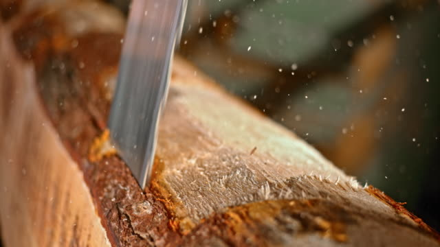 SLO MO Blade of vertical saw cutting a log video