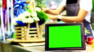 Blank tablet PC with a green screen video