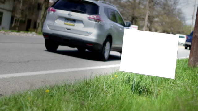 Blank tacky sign on the side of the road in afternoon video