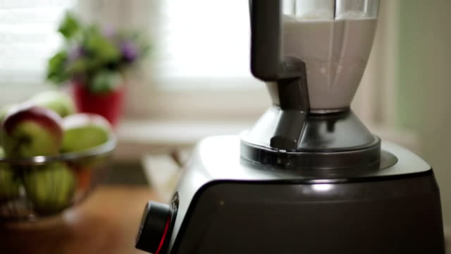 A blender with cream is working. video