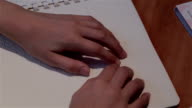 Blind hand with disability touch and read text braille system language video