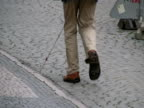 Blind Man Uses Cane - Hand Held video