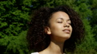 Blissful woman enjoying freedom and life in park. video