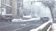 Blizzard cars driving in city slow motion video