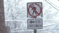 Blizzard no walk sign and use crosswalk slow motion video