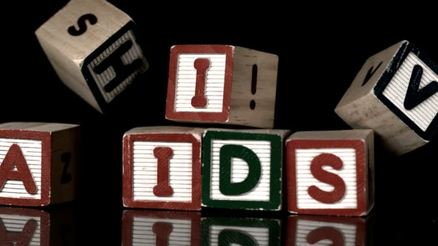HIV blocks falling on AIDs video