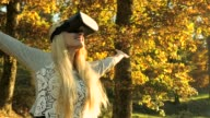 Blond beauty having fun with VR in nature video