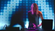 Blond Female DJ Dancing behind Mixer video