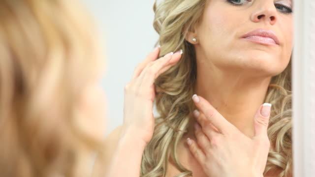 HD 1080: Blond woman examining her skin video